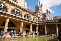 Roman Baths in Bath. Thermal roman pool with cathedral, column ans statues in a sunny day. - u;tra wide lens - Bath (UK) 07/2015 Royalty Free Stock Photo