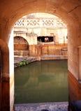 Roman Baths, Bath. View through an archway to the Sacred Spring Roman Baths, Bath, Avon, England, UK, Western Europe Royalty Free Stock Image