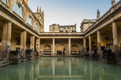 Roman Baths, public bath house in Roman period. BATH, UK - DECEMBER 13 2017: Tourists visiting inside the Roman Baths on December 13,2017 in Bath, UK Stock Photo