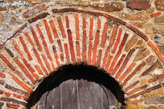 Roman brick arch. Dating from the seventh century AD, an arch made of roman bricks above a side door at the anglo-saxon christian church of All Saints at Royalty Free Stock Photos