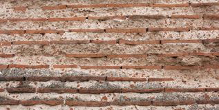 Roman brick texture wallpaper Stock Image