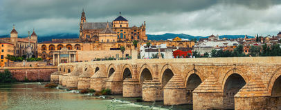 Roman bridge across the Guadalquivir river and La Mesquita Cathedral in Cordoba, Spain Stock Photography