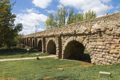 Roman bridge. Ancient Roman bridge on Tormes river near Salamanca, Spain Stock Photo