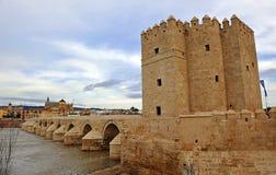 Roman bridge and Calahorra tower, Guadalquivir River, Cordoba, Spain. The great Roman bridge crossing over the river Guadalquivir, Calahorra tower was a fortress stock photo