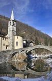 Roman bridge with church. In Fontainemore, Aosta Valley, Italy stock photos