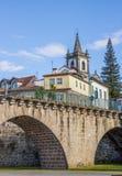 Roman bridge in front of a church in Ponte da Barca Stock Photography