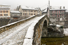 Roman bridge at Giornico onder snow on Leventina valley Royalty Free Stock Images