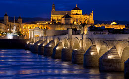 Roman Bridge and The Great Mosque (Mezquita Cathedral) in Cordona Stock Photo