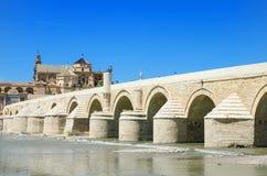 Roman bridge and Guadalquivir river in Cordoba, Andalusia, Spain Stock Photos