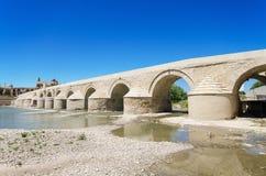 Roman bridge and Guadalquivir river in Cordoba, Andalusia, Spain. Roman bridge and Guadalquivir river over blue bright sky in Cordoba, Andalusia, Spain stock photos