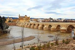 Roman Bridge, Guadalquivir River, Cordoba, Spain. The great Roman bridge crossing over the river Guadalquivir, the building of the Great Mosque of Cordoba you stock images