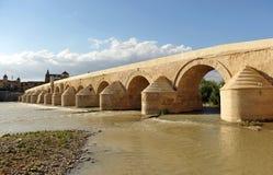 Roman Bridge, Guadalquivir River, Cordoba, Spain. The great Roman bridge crossing over the river Guadalquivir, the building of the Great Mosque of Cordoba you royalty free stock photos