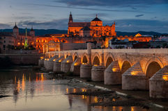 Roman bridge and La Mezquita at sunset in Cordoba Royalty Free Stock Photo