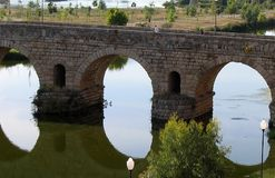 Roman Bridge at Merida, Spain. Bridge Reflex at Merida, Spain Stock Photo