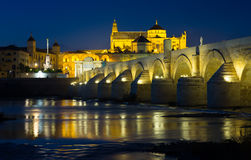 Roman bridge and  Mosque-cathedral of Cordoba in evening. Old roman bridge and  Mosque-cathedral of Cordoba in evening time Stock Image