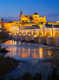 Roman bridge and  Mosque-cathedral of Cordoba in night Stock Images