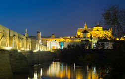 Roman bridge and  Mosque-cathedral of Cordoba in night Stock Photo