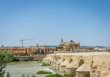 The roman bridge and the Mosque Church of Cordoba across the Guadalquivir river, SPain, Europe, Andalucia. The roman bridge and the Mezquita de Córdoba,the royalty free stock photo