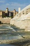 Roman bridge and mosque of cordoba. Guadalquivir river under the roman bridge of cordoba stock photo