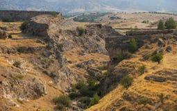 The Roman bridge near Hieropolis. The ruins of a Roman bridge near ancient Hieropolis city at the Denizli Province, Turkey Stock Image