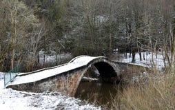Roman Bridge in neve Fotografie Stock