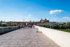 Roman Bridge over Guadalquivir River with Mosque on background stock photos
