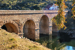 Roman bridge over river Erges royalty free stock photography