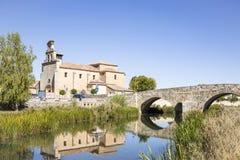 Roman bridge over Ucero river and Santa Cristina church - El Burgo de Osma town, Soria, Spain. Roman bridge over Ucero river and Santa Cristina church - El Burgo Stock Image