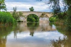 Roman bridge. River under the bridge roman Royalty Free Stock Photography