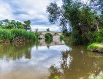 Roman bridge. River under the bridge roman Stock Photography