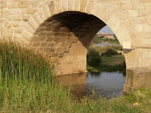 Roman Bridge In Spain. Roman bridge eye opening in Merida, Extremadura in Spain Stock Photo