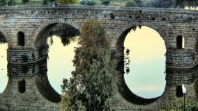 Roman bridge. (1st century BC) and reflections over the Guadiana river (Spain royalty free stock photography