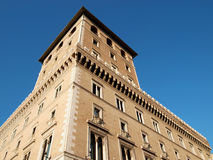 Roman building. Old Roman building with large windows and battlements decoration in Rome, Italy Stock Images