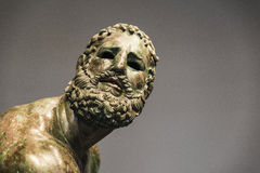Roman bust or statue made with bronze of a human face Royalty Free Stock Images