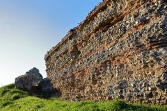 Roman castle walls at Burgh Castle in Norfolk. Huge Roman fortress walls built around 300AD at Burgh Castle to defend Norfolk, England, from raids by Saxon Royalty Free Stock Images