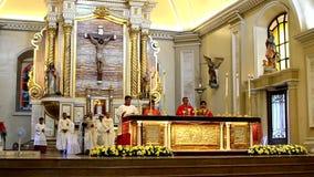 Roman Catholic altar Mass Ritual introduction. San Pablo City, Laguna, Philippines - October 20, 2016: Roman Catholic opening Ritual introduction for priests stock video