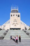 Roman Catholic Cathedral, Liverpool. Teachers with a party of school children by the steps leading to the Roman Catholic Cathedral, Liverpool, Merseyside stock image