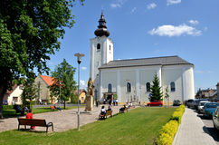 Roman Catholic Church of saint Gall in summer and some people arround Royalty Free Stock Image