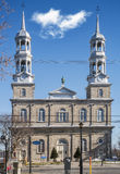 Roman Catholic Church in St-Eustache. L'Église Chrétienne Évangelique de St-Eustache was born in an old house near the large Roman Catholic Church in stock images