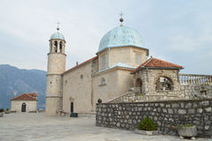 Roman Catholic church of Virgin Mary on Our Lady on the Rocks islet in the bay of Kotor, Montenegro Stock Images