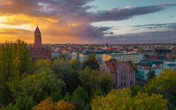 The Roman Catholic Co-Cathedral St. Stanisław Biskupa Martyr in Ostrow Wielkopolski, Poland. Aerial view to church and old town during sunset stock photography