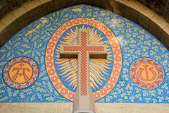 Roman Catholic cross over the entrance of a church royalty free stock images
