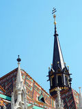 Roman Catholic Matthias Church in Budapest. Matthias Church closeup, spires and towers, (Hungarian: Mátyás-templom) is a Roman Catholic church located in Royalty Free Stock Photo