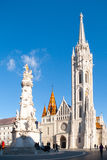 Roman Catholic Matthias Church and Holy Trinity plaque column at Fisherman`s Bastion in Budapest, Hungary, Europe Stock Image