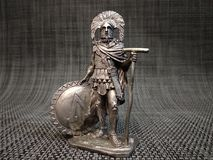 Roman centurion with a Spartan shield. A Roman centurion figure made from metal Royalty Free Stock Images