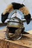 Roman centurion helmet. On a wooden chest Stock Photo