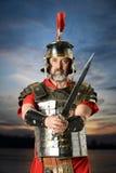 Roman Centurion Holding Sword Fotografia Stock Libera da Diritti