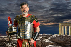 Roman Centurion with Metal Armor. Portrait of Roman Centurion outdoors in front of rocks Royalty Free Stock Image