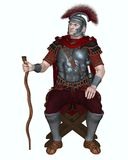 Roman Centurion with Transverse Crest and Vine Staff. Centurion of the Imperial Roman legionary army wearing a transverse crested helmet and sitting on a folding Royalty Free Stock Images