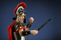 Roman Centurion Using Sword. Roman centurion screaming and using sword Stock Photography
